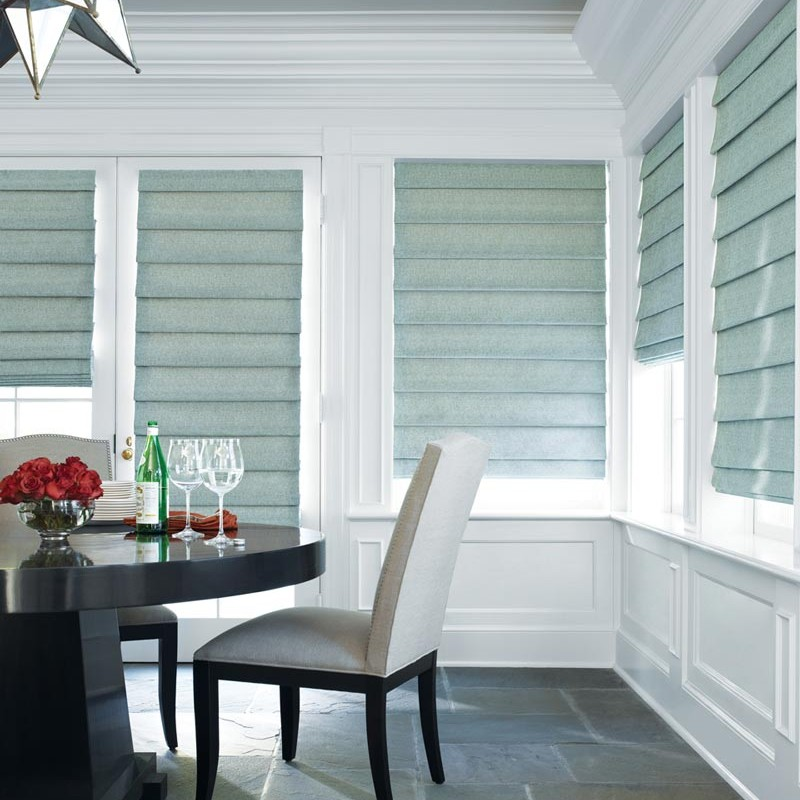 Roman shades in a white room